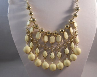 4 Row Bib Necklace with Gold Tone and Cream Color  Pendant Beads on a Gold Tone Chain