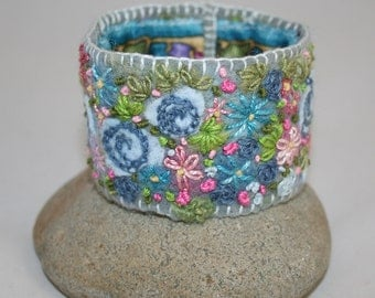 Embroidered Cuff - Blue and Raspberry Pink Rose border Felted and stitched by Lynwoodcrafts