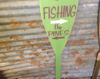Trails, fishing, the pines, ore shaped wood sign