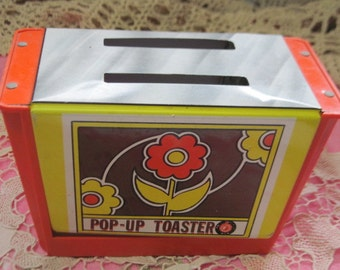 Toy Vintage Pop Up Toaster / WOLVERINE ? / Orange ,Yellow and Brown with Pretty Flowers on it. Plastic and Metal  :)