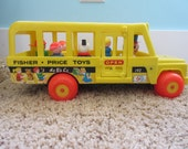 Vintage Fisher Price school bus, number 192, plus 5 people and one dog