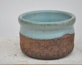 Rustic ceramic bowl with blue green glaze and natural clay, pottery bowl