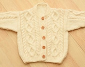 toddlers hand knitted aran style cardigan age 1 to 2 years in cream