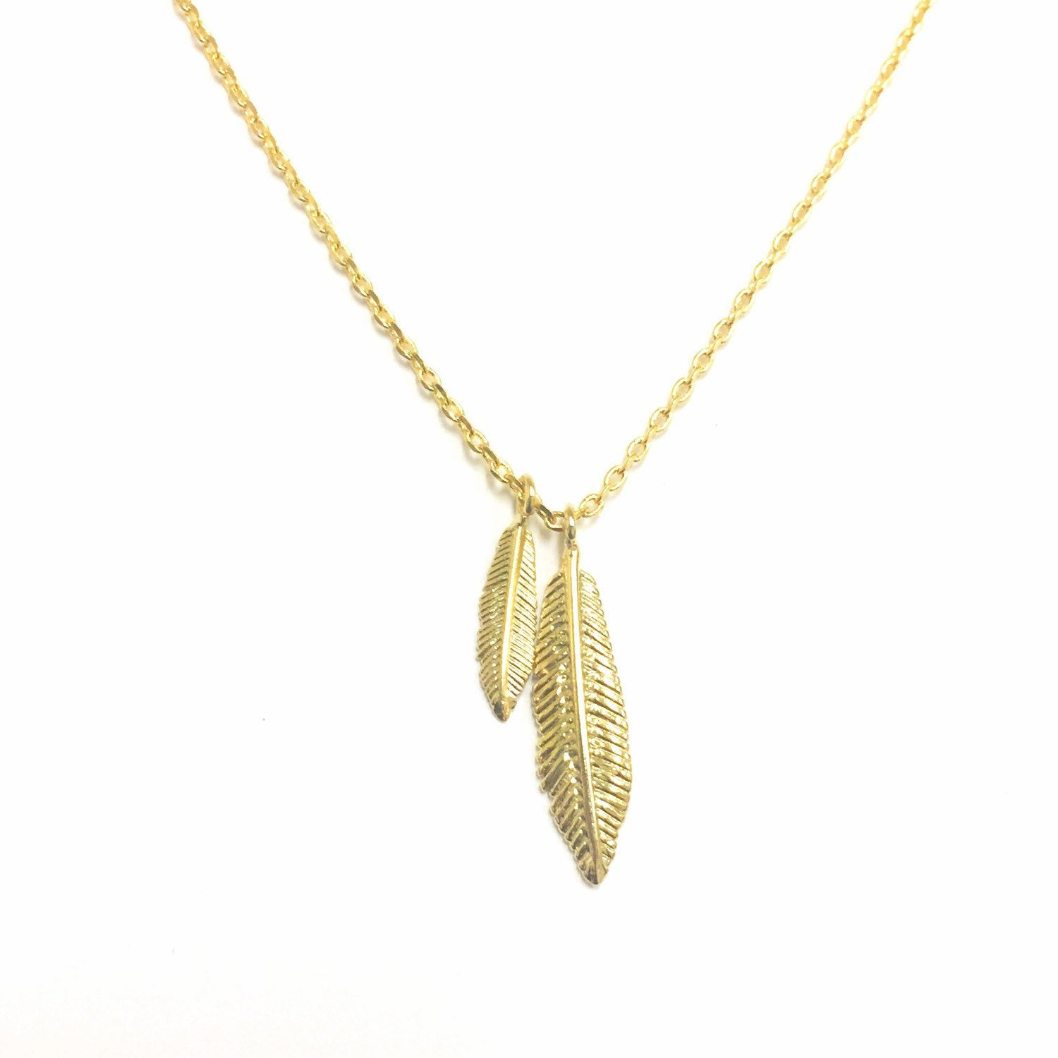 tiny gold feather necklace american