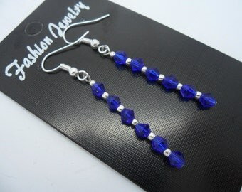 A pair of hand made silver plated cobalt blue crystal dangly earrings.