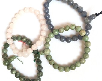 Power stone bracelets (from left to right - rose quartz, green agate, brown agate, blue agate). Please pick the item(s) you like.