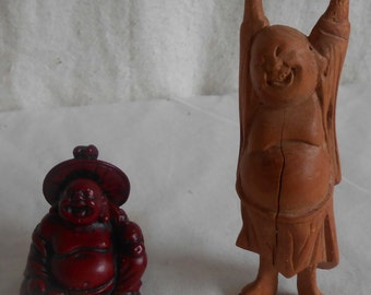 Two Happy Buddahs one Sitting one Stretching