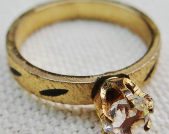 Cubic Zirconia and Gold Tone Solitaire Ring with Decorated Textured Band size 2.5