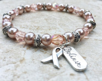 Breast Cancer Awareness bracelet, pink with silver ribbon and Believe charm, cancer support
