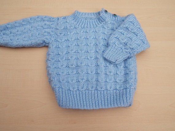 Baby boy jumper hand knitted in blue with elephant buttons 0