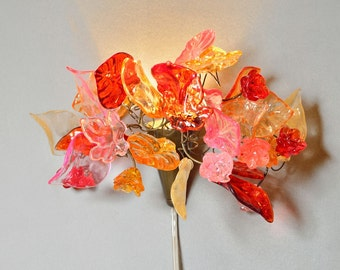 Bouquet wall light with flowers and leaves at romantic color for bedroom side lighting or children room.