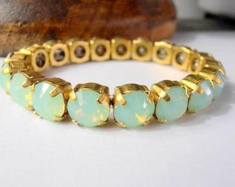 Swarovski Bracelet, 8mm, Crystal, Chrysolite Opal Chatons, Antique Gold setting, Stretch Bracelet