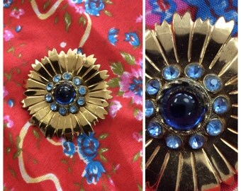 Vintage gold brooch with blue gems