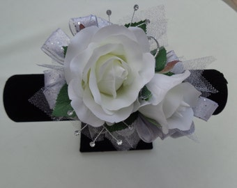 2 Piece wrist corsage and boutonniere with white roses and silver trim