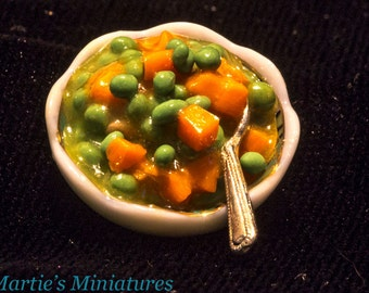 Miniature Bowl of Peas & Carrots in a White and Green china Bowl (A)