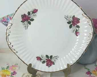 Vintage cake plate with red roses by Lubern bone china with 22 kt gilding. Made in England.