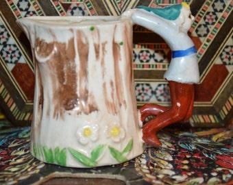 Elf-handled cream pitcher