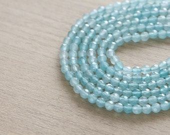 50 pcs of Natural Dyed Jade Clear Light Blue Round Faceted Beads - 4 mm