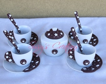 4 coffee cups with decorative sponge stars