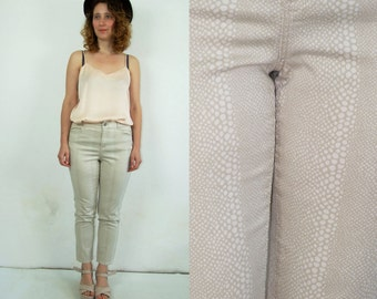 90's vintage women's beige spotted  high waisted pants