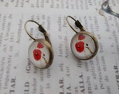 Red poppies in white background glass cabochon French back earrings