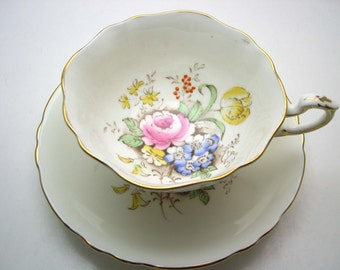 Double Warrant Paragon Tea cup And Saucer, Light Ivory Teacup Set with Bouquet of Flowers,  English tea cup set.