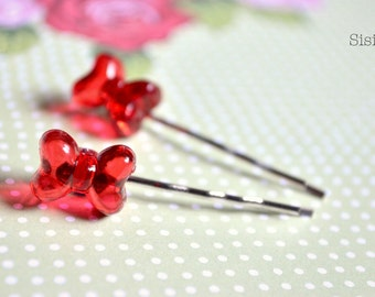 Pair of red bow hair barrettes