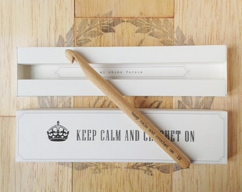 Personalized wooden crochet hook and case.