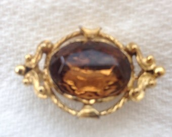 Smoky topaz glass and goldtone brooch