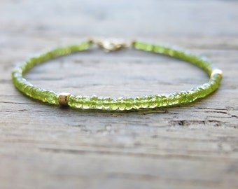 Peridot bracelet and  sterling silver gold plated accents. Green peridot bracelet. August birthstone.