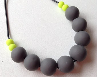 Polymer clay necklace, charcoal with fluoro yellow