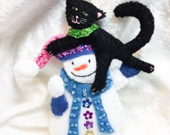 Happy snowman with a black cat