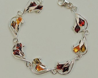 Genuine Baltic amber sterling silver bracelet .