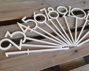 Stick Table numbers - the idea of combining your centerpiece and table numbers together use these wedding table numbers on sticks