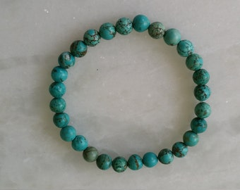 Turquoise green stretch bracelet, beaded 7""