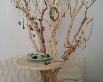 Jewelry tree in a sandblasted color and rotating base. A beautiful way to display all your jewelry and accessories.