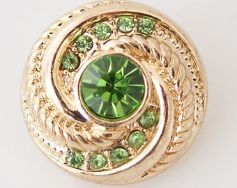 KB6180  Faceted Gold Swirl Charm with Large Green Center Surrounded by Smaller Crystal Stones