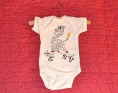 Giraffe Rollerskating Onesie: 100% organic cotton with screenprint, embroidery and appliqué