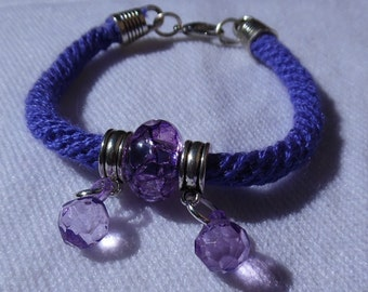 New bracelet made with the technique Kumihimo braiding and two purple beads/boho, fashion, trendy