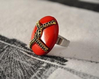 Ring with original '70 red button