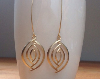 Matte gold oval eye earrings