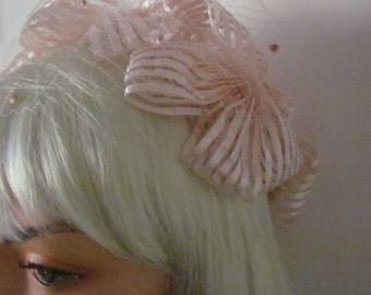 """1950,s very pretty pink glace straw caplet with """"bows"""" and pink spot veiling"""