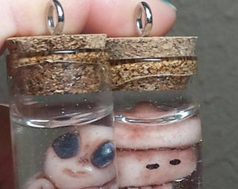 tiny weird Extraterrestrial Alien or Squid fetus soecimen in jar Charm for necklace oddities
