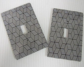 2 light switch covers, black and white zig zag pattern design
