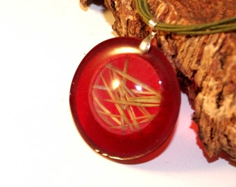red pendant with grass inside