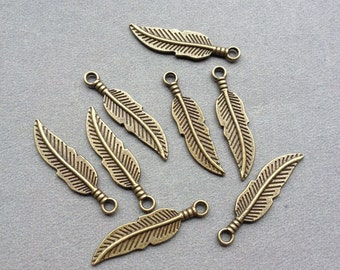 100 pcs 8x29mm of Antique Bronze Leaf Pendants Charms