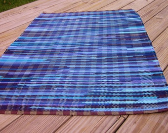 shades of blue and black handwoven rag rug made from recycled t-shirts