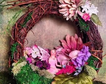 Fairy kneeling in a nest of flowers