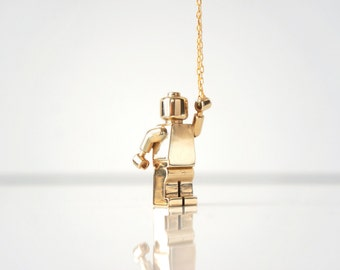 Kid at Heart - Don't Lego by TO+WN DESIGN -  a necklace collection inspired by nostalgic childhood toys, brass lego man gold minifig