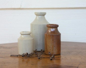 Antique stoneware bottles - collection of three
